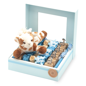 BABY GIRAFFE BOY Blue Window Gift Box with plus giraffe laying on a bed of Belgian chocolate individually wrapped in ivory and pink foil with decorations organized in rows
