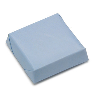 a muted blue colored paper double wrapped chocolate square