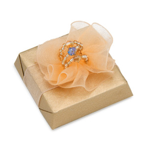 Peach tulle decoration on beige foil wrapped chocolate square