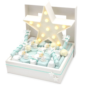 IVORY WINDOW BOX WITH ALTERNATING ROWS OF TURQOUSE AND WHITE INDIVIDUALLY WRAPPED CHOCOLATES WITH A LARGE STAR LIGHT