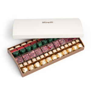 White and gold Mirelli box open displaying an assortment of gold, rose petal chocolate, green and red wrapped chocolates