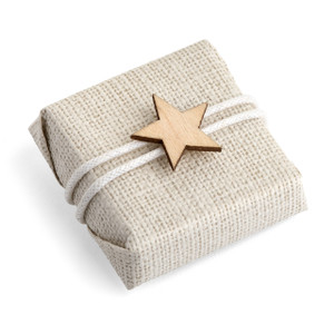 Square chocolate with tan textured paper, white cord double wrapped around and a small wooden star in the center