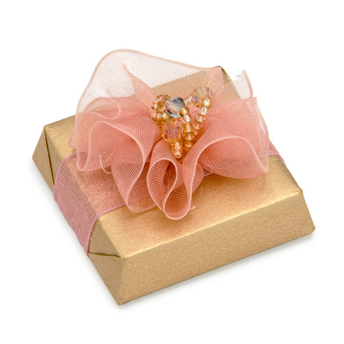 Tulle decoration on square chocolate with beige foil wrapping