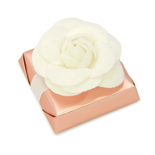Metallic peach colored wrapping with single ribbon under faux off -white Chanel style flower