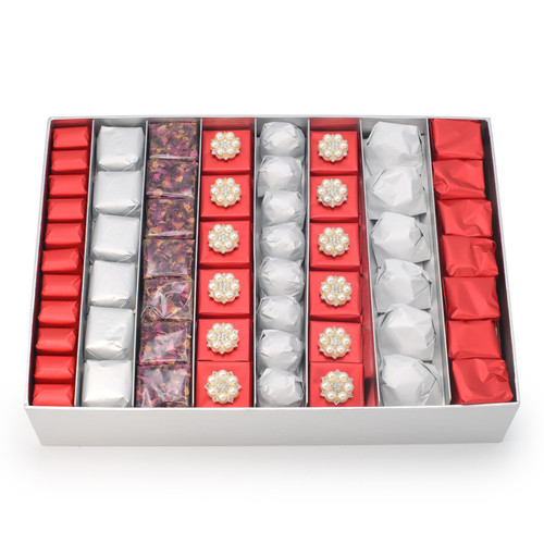 Alternating rows of red, silver with two rows of decorated red chocolate with 6 pearl