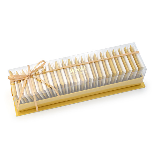 alternating rows of gold and white individually wrapped semi sweet chocolate squares in a gold box with a thin gold bow