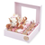 BABY GIRAFFE GIRL Pink Window Gift Box with plus giraffe laying on a bed of Belgian chocolate individually wrapped in ivory and pink foil with decorations organized in rows