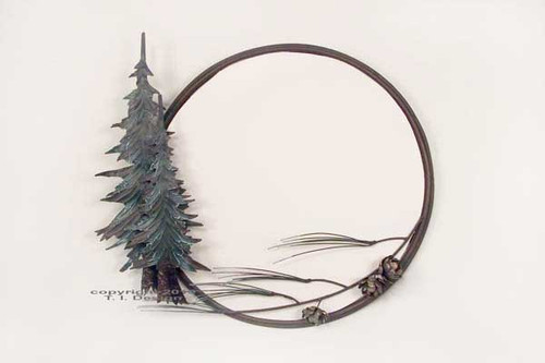 Hand crafted mirror in a sculptured metal frame. Surrounded by pine trees and a spread of pine branches with pine cones, grace the bottom right