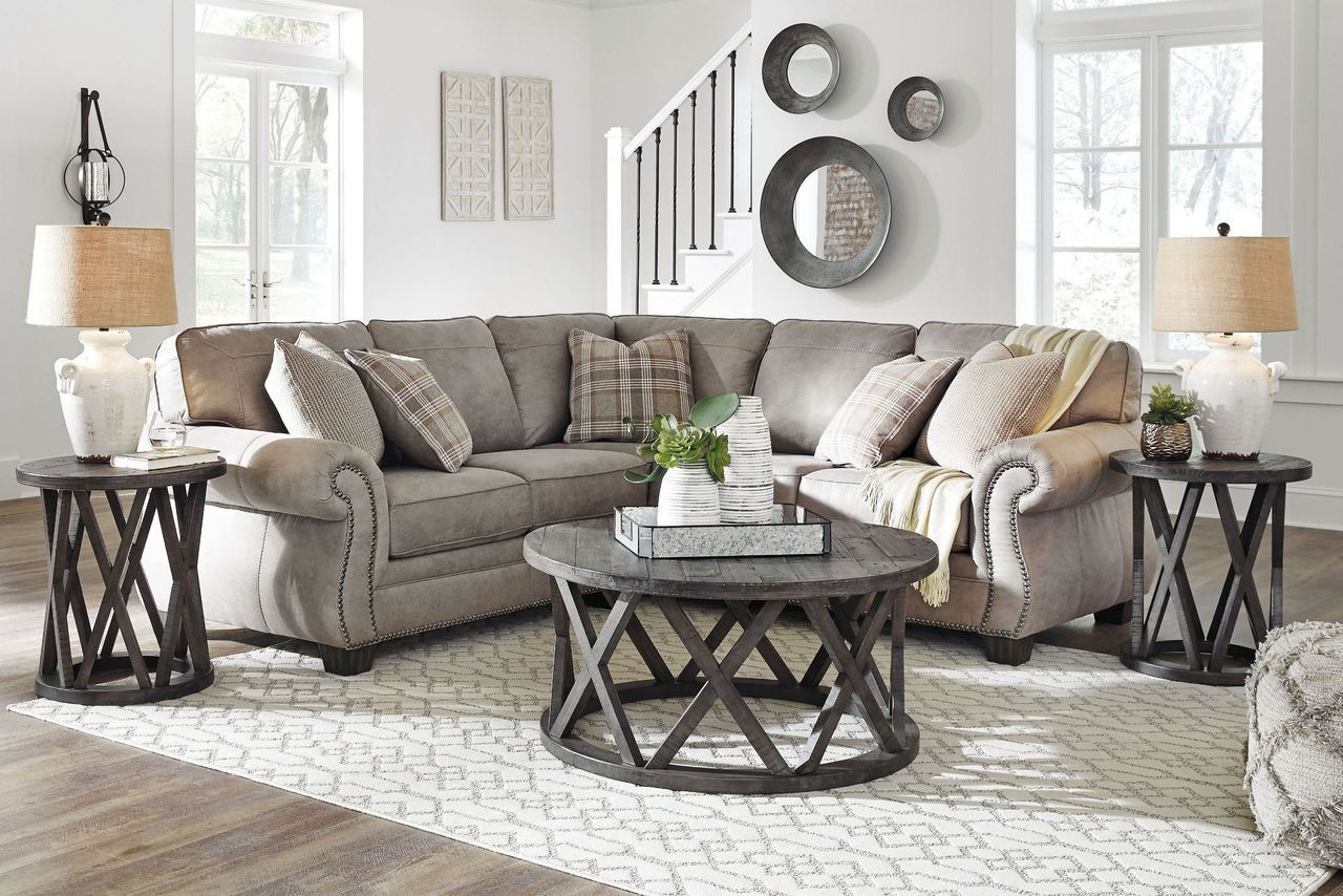 The Olsberg Steel Laf Loveseat Raf Sofa With Corner Wedge Sectional Sharzane Cocktail Table 2 End Tables Available At Discount Furniture Center Serving South Hill And Farmville Va