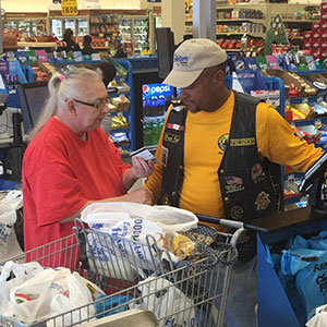 The Buffalo Soldiers purchasing groceries for veterans.