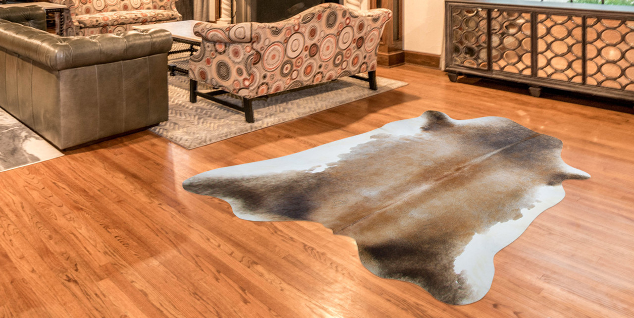 cow hide in brown and cream on lounge floor