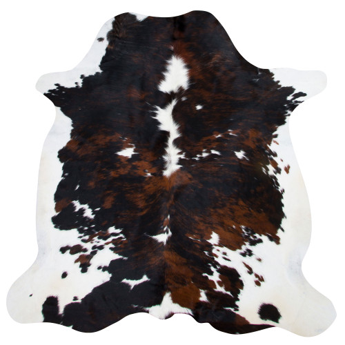 cowhide rug in different hues of browns on white