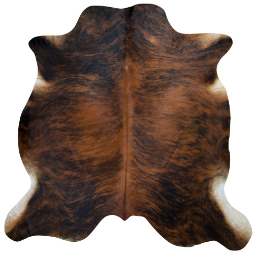 brindle cow hide rug in hues of caramel and mocha