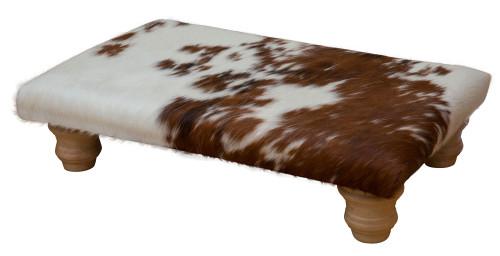 Footstool upholster in cowhide