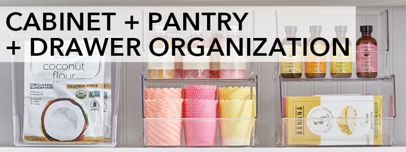clear storage bins with colorful baking supplies