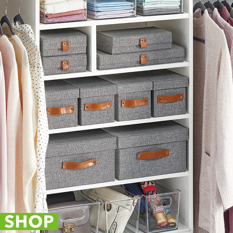 Gray bins with lids and handles in an organized closet