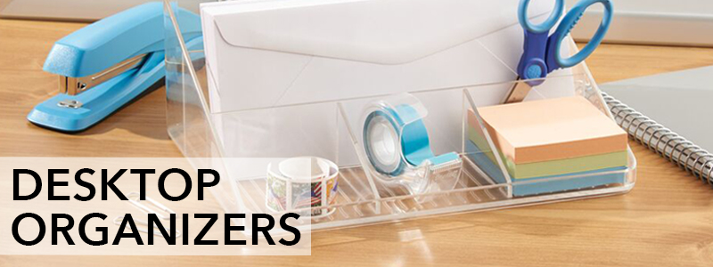 Clear divided desk organizer with scissors, note pads, envelope, and stapler