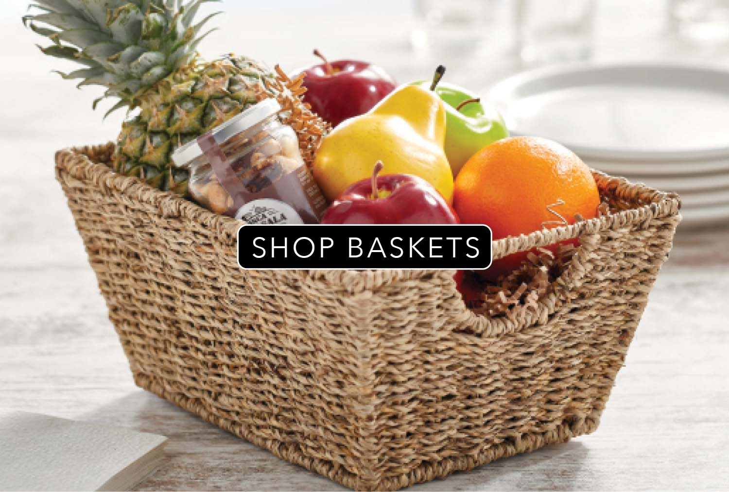 woven brown basket with fruits and jars