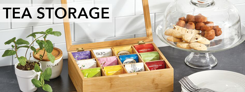 Bamboo lidded tea storage box with tea bags in kitchen