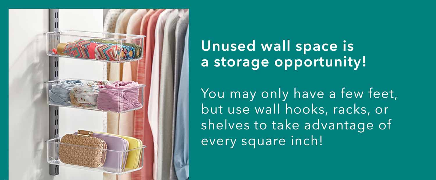Clear storage bins attached to wall in organized closet