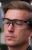 Uvex Genesis Bifocal Safety Glasses with Black Frame and Gray Ultra-Dura Lens - Man Wearing Uvex Genesis Readers
