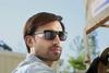 KleenGuard Maverick Safety Glasses with Black Frame and Gray Anti-Fog Lens lifestyle image