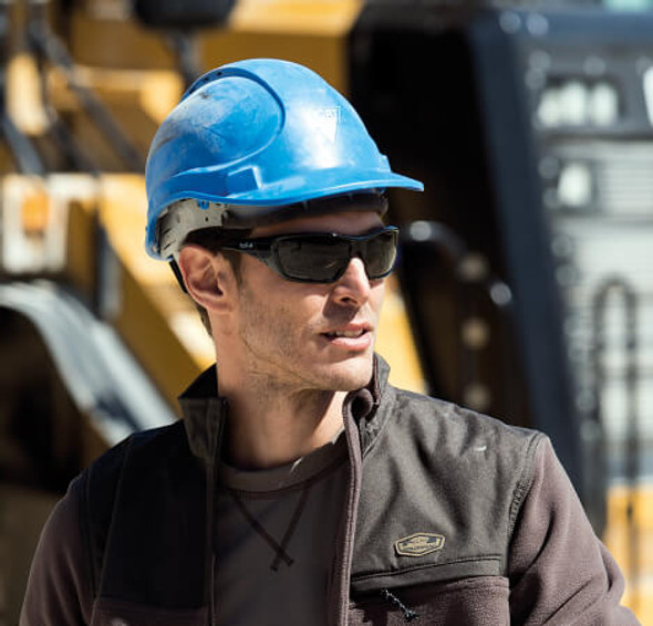Bolle Hustler Safety Sunglasses with Shiny Black Frame and Smoke Anti-Scratch and Anti-Fog Lenses - Man Wearing Bolle Hustler While Working