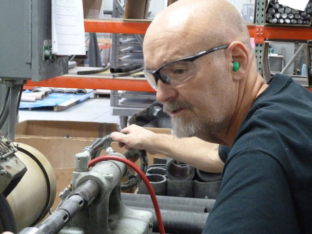Working Wearing Elvex Rx-500 Safety Glasses with Black Frame and Clear Lens with Full Magnifier 1