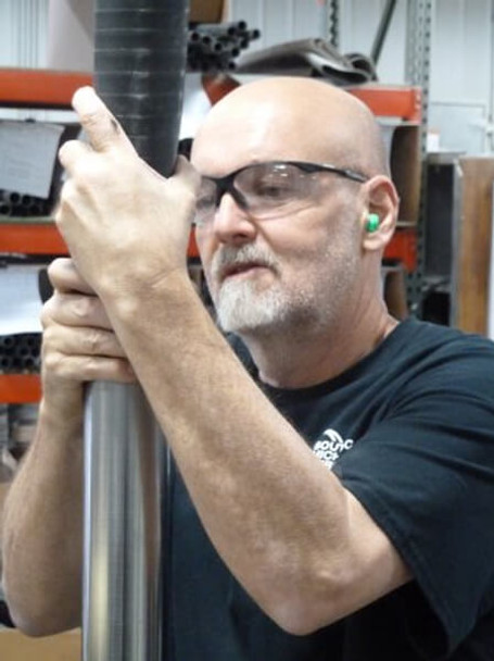 Working Wearing Elvex Rx-500 Safety Glasses with Black Frame and Clear Lens with Full Magnifier 3