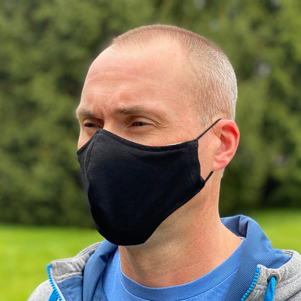 Cloth Face Mask Washable & Reusable 100% Cotton With Adjustable Ear Loops - being worn, 3/4 view