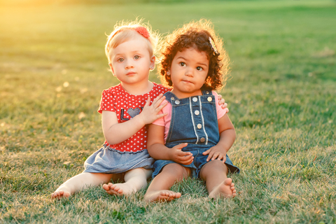 two-toddler-girls-sitting-on-grass.jpg