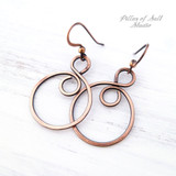 copper infinity hoop earrings by Pillar of Salt Studio