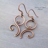 copper wire wrapped flourish earrings by Pillar of Salt Studio