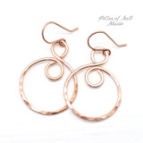 rose gold filled infinity hoop earrings worn on The Village season 1 episode 8