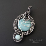 Antiqued Sterling Silver wire wrapped pendant with Amazonite stones.