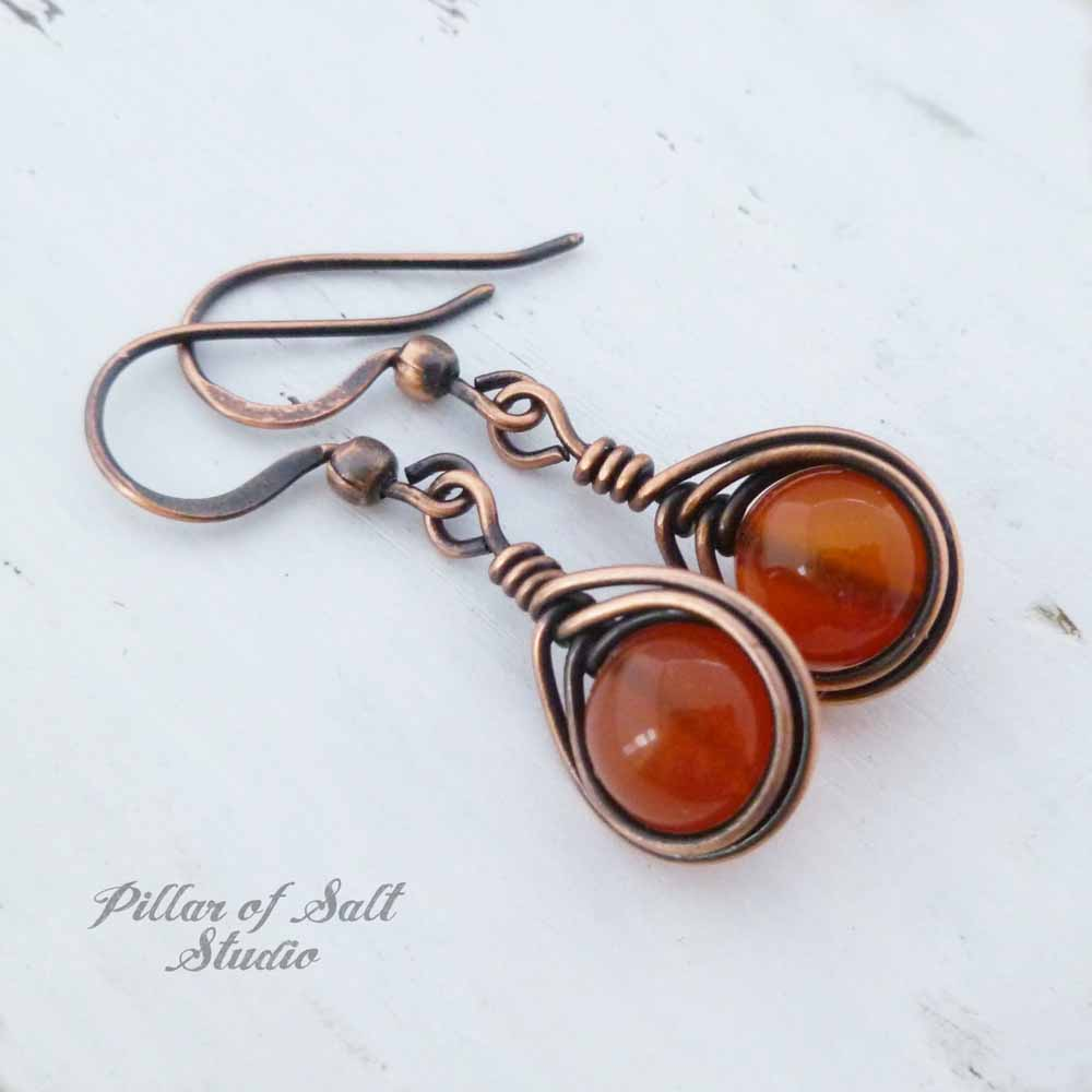 Red Carnelian and copper wire wrapped earrings handcrafted by Pillar of Salt Studio