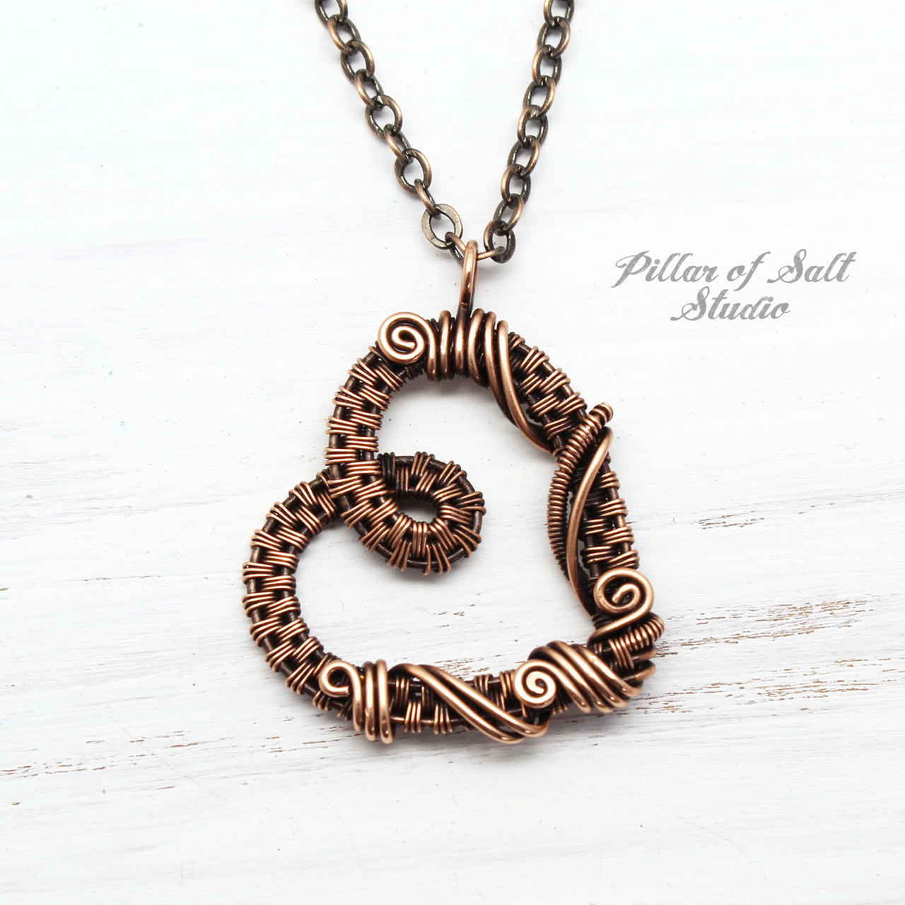 Copper woven wire heart pendant by Pillar of Salt Studio