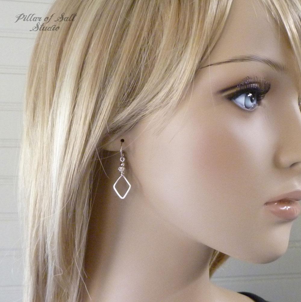 Silver earrings worn the Arrow / Pillar of Salt Studio