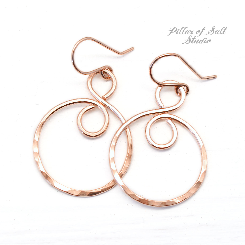 rose gold filled infinity hoop earrings worn on The Village season 1 episode 8
