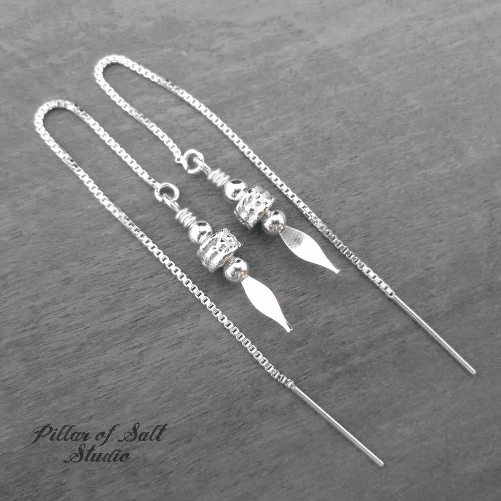 "Silver threader earrings worn by Felicity on ""Arrow,"" made by Pillar of Salt Studio"