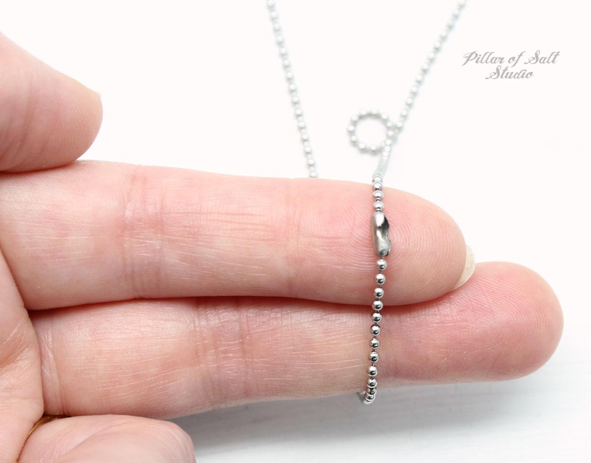 small, unobtrusive clasp