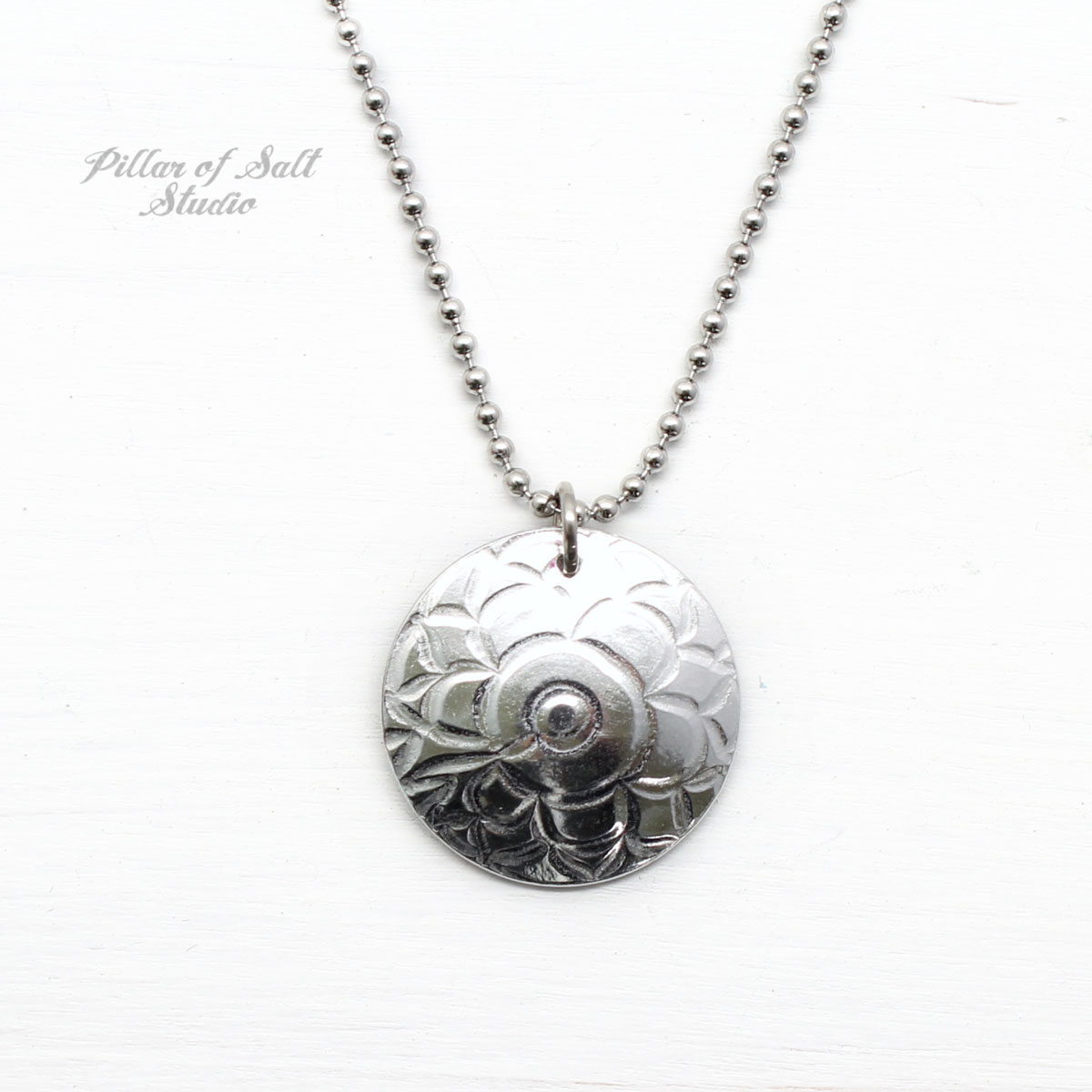 small textured aluminum disc with stainless steel ball chain.