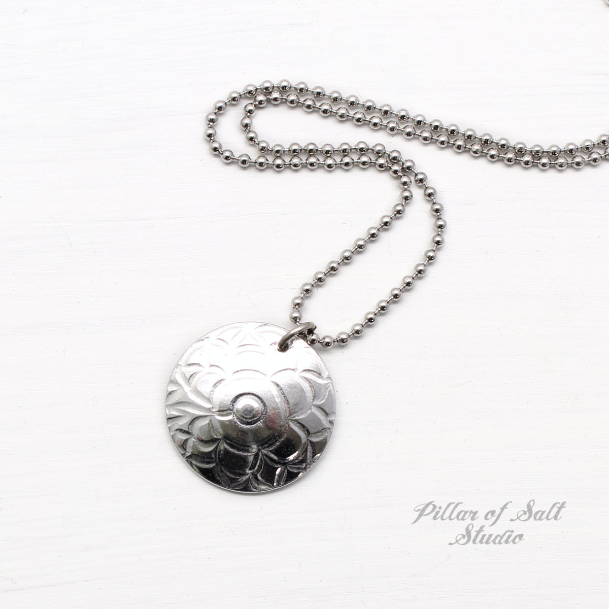 shiny, small textured aluminum disc with stainless steel ball chain.