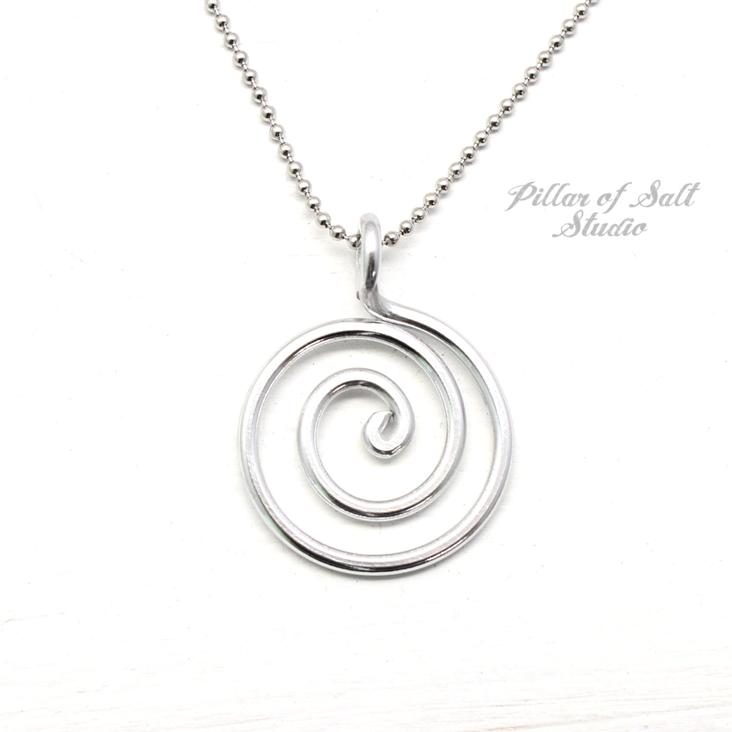 aluminum wire wrapped pendant with stainless steel chain.