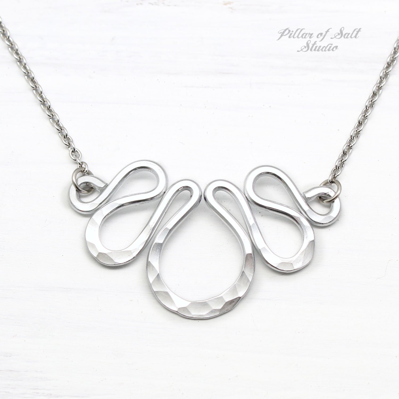 Hammered aluminum bib necklace by Pillar of Salt Studio