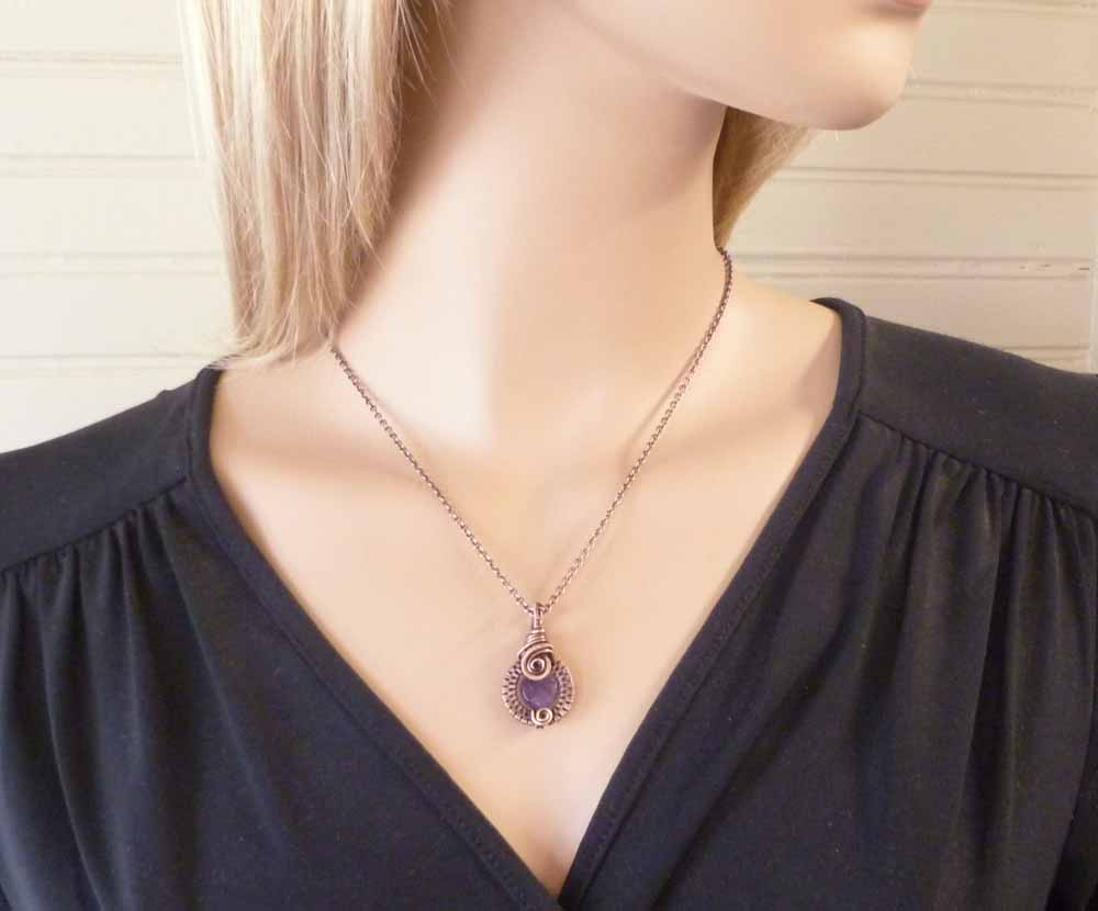 Amethyst pendant of the same size shown for size reference.