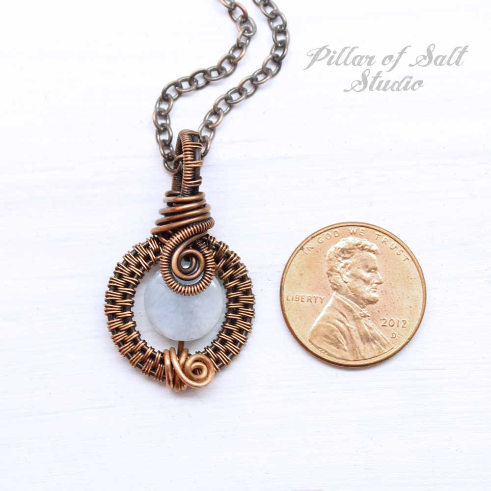 This small woven wire pendant measures about 1.25 inch high.