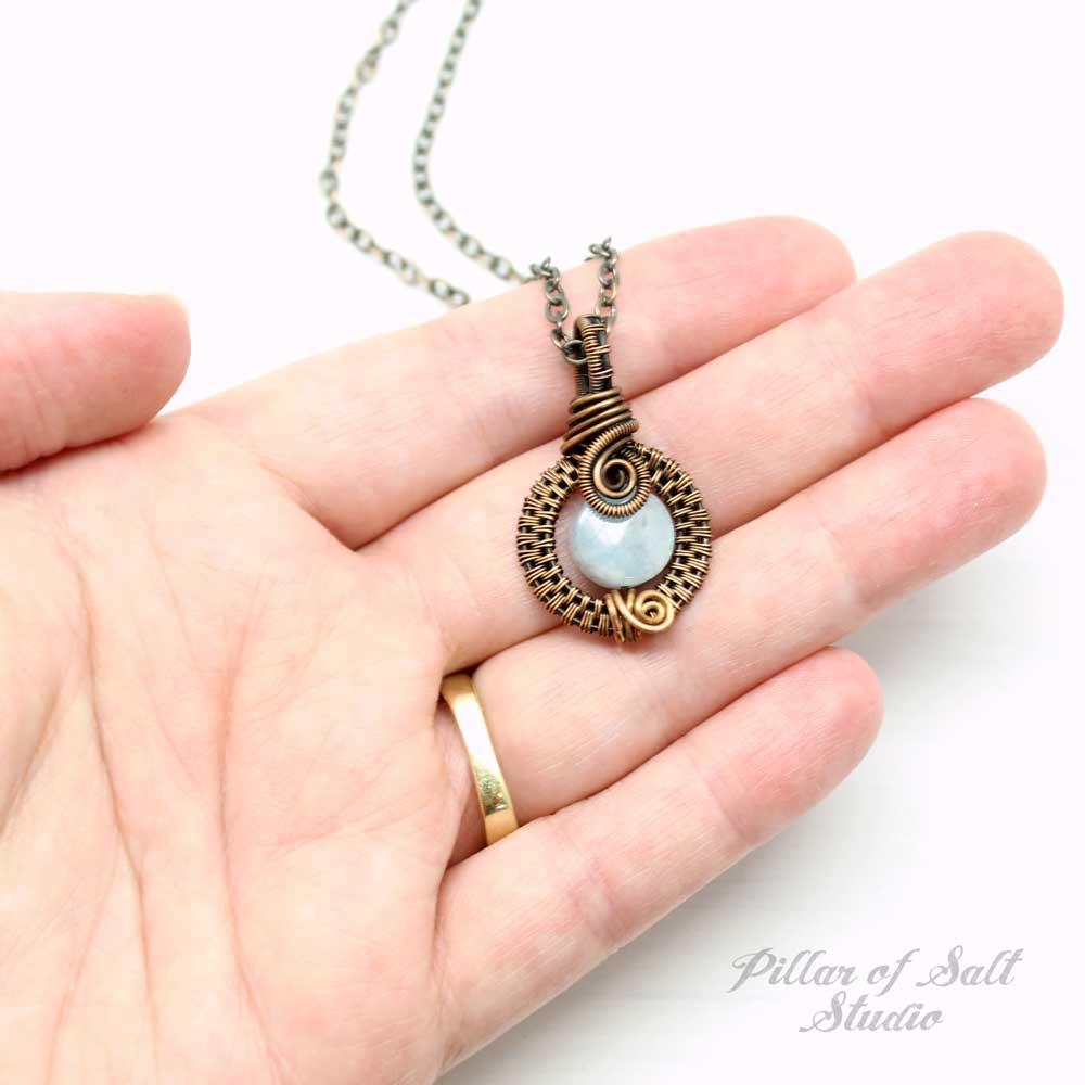 Copper wrapped aquamarine gemstone pendant.