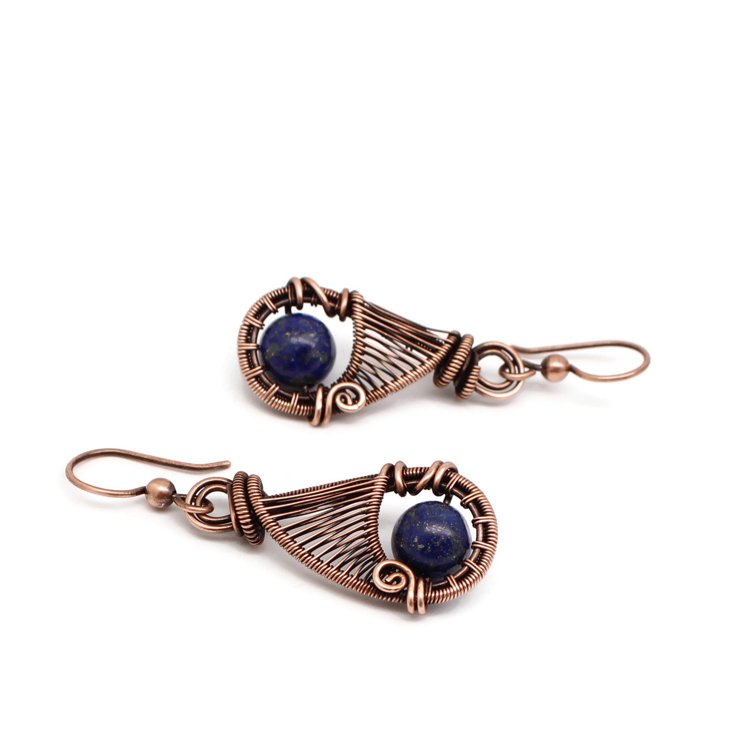 Copper wire wrapped earrings with blue lapis stones.