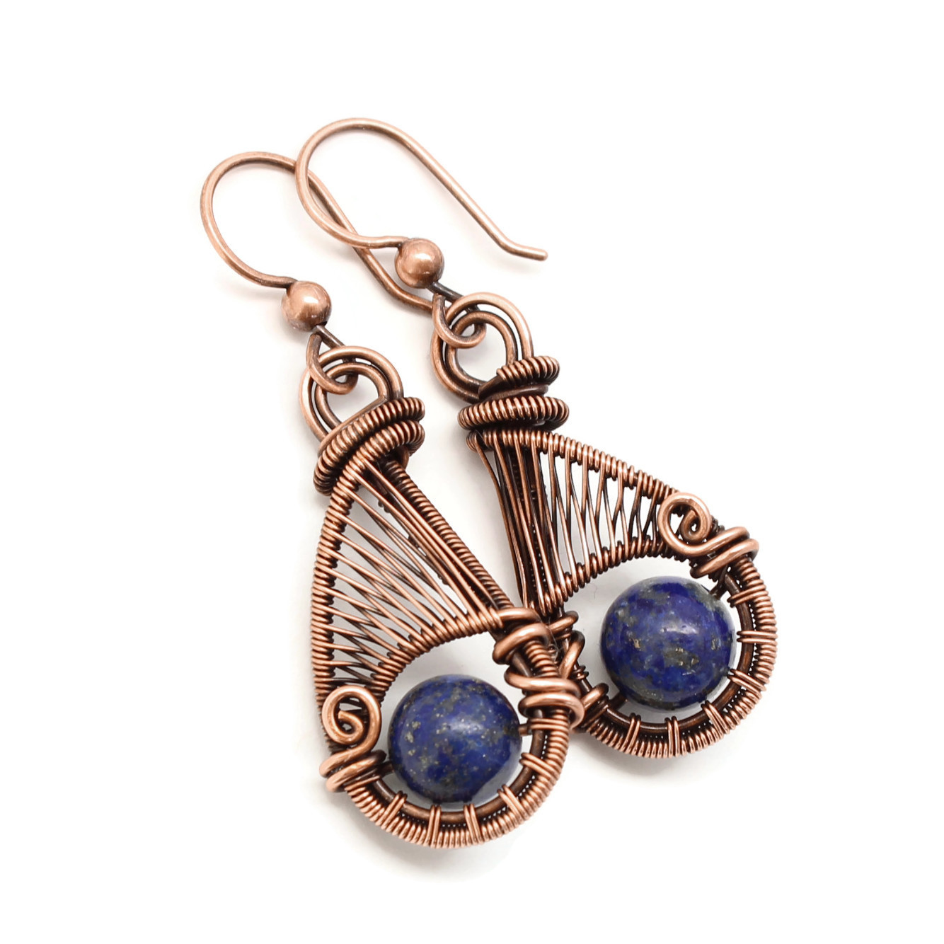 Copper wire wrap earrings with lapis lazuli gemstones.